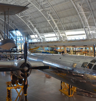 "Steven F. Udvar-Hazy Center: south hangar panorama, such as Vought OS2U-3 Kingfisher seaplane, B-29 Superfortress ""Enola Gay"", amongst other folks"